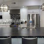 Granite island. Quartz counter and decorative splash